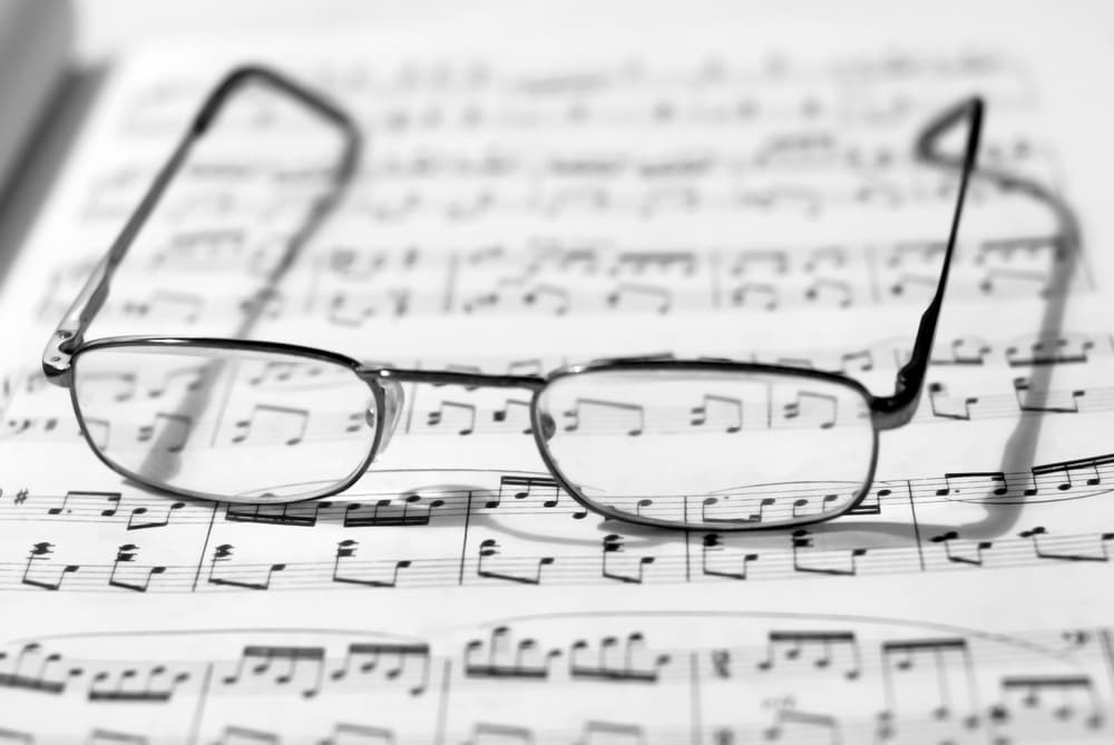 Sheet piano music and glasses for short-sightedness
